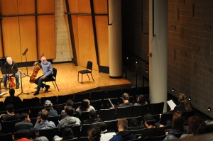 During an open reading session for student compositions, cellist and Playground Ensemble member Richard vonFoerster gives feedback to the composer.