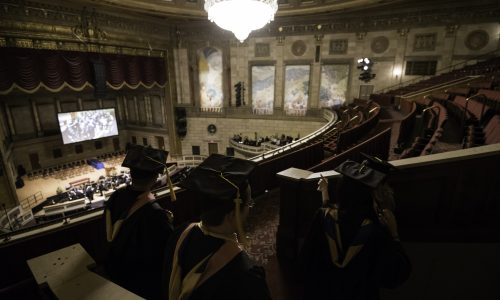 Candidates survey Kodak Hall before the ceremony. // University of Rochester Eastman School of Music Commencement Ceremony, Kodak Hall at Eastman Theatre May 20, 2018.  // photo by J. Adam Fenster / University of Rochester