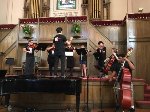 Student conducting in church setting