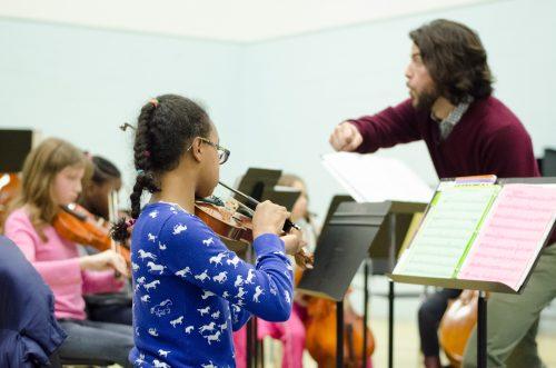 Children in orchestra lesson