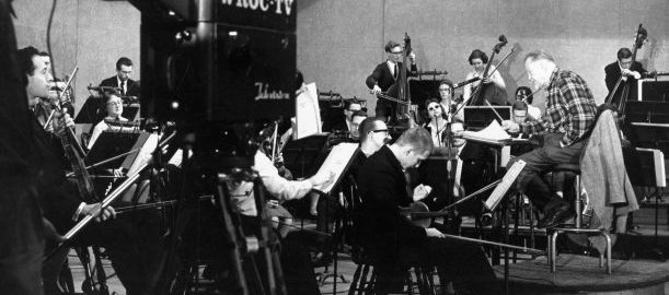 Howard Hanson conducts the Eastman Philharmonia on the WROC-TV studio stage, with a WROC-TV camera in the foreground.