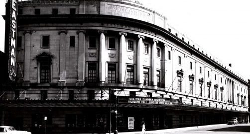 Black and white photo of the exterior of Eastman Theatre, viewed from the northwest corner of Main Street and Gibbs Street (circa 1940 to 1950s).