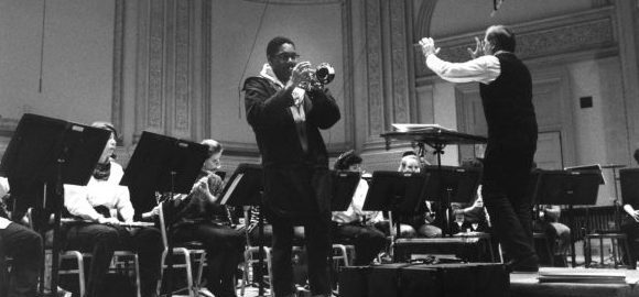 The Eastman School Photo Archive contains several thousand photographs documenting the school's rich history. Among the collection is this photograph of Wynton Marsalis rehearsing with Donald Hunsberger and the Eastman Wind Ensemble. [ESPA, 8x10 series, 18/33]