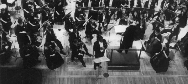 Overhead view of William Warfield performing on stage with the Eastman Philharmonia at a Washington D C concert.