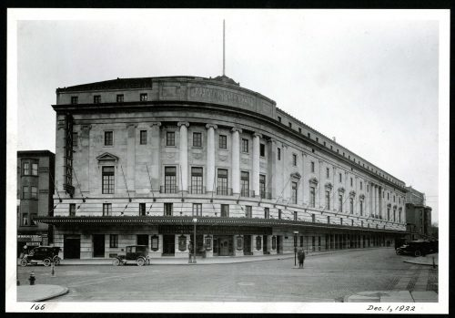 Black and white photo of the exterior of Eastman Theatre, viewed from the northwest corner of Main Street and Gibbs Street (1922).
