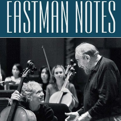 Excerpt of the front cover of the Winter 2000 issue of Eastman Notes, showing a photo of Mitch Miller chatting with students during an Eastman Philharmonia rehearsal.