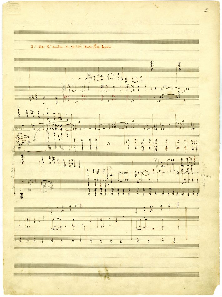 La mer, 1st page of movement 1: movement title in red pencil, music notation in black ink, and corrections in pencil.