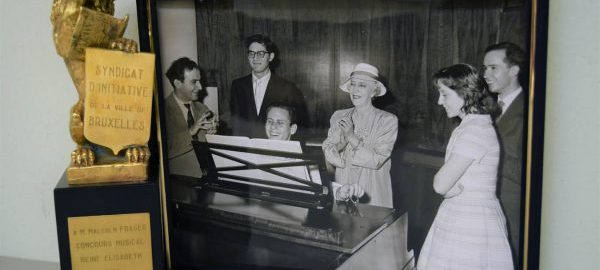 The Malcolm Frager Collection documents the pianist's extensive and prestigious international career. Some memorabilia, such as this trophy and photograph from the 1960 Queen Elisabeth of Belgium Competition, are included among Frager's other personal papers (e.g., programs, publicity, correspondence) and library. [Trophy from Malcolm Frager Collection (2013 Gift), Box 23/1; photograph from Malcolm Frager Collection (1992 Gift), Box 58/5]