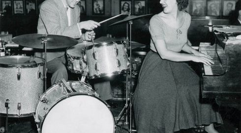 "The Marian McPartland Collection includes a large series of photographs from McPartland's professional career, including this photograph of Joe Morello and Marian McPartland performing at the Hickory House in NYC (ca. 1950s), which was taken by the prolific New York-based entertainment photographer William ""PoPsie"" Randolph. [Marian McPartland Collection, Box 26, Folder 4, Sleeve 5]"