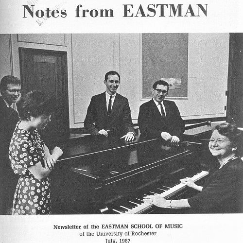 """Cover of the July 1967 issue of """"Notes from Eastman"""" showing a candid photo of five people standing around a grand piano."""