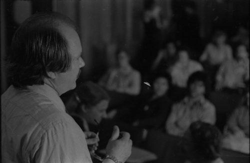 John Perry addressing listeners in Howard Hanson Hall.