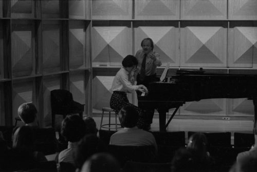 John Perry coaching an Eastman piano major on-stage in Howard Hanson Hall.