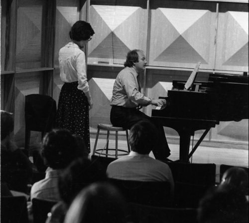 John Perry demonstrating a passage at the keyboard in Howard Hanson Hall.
