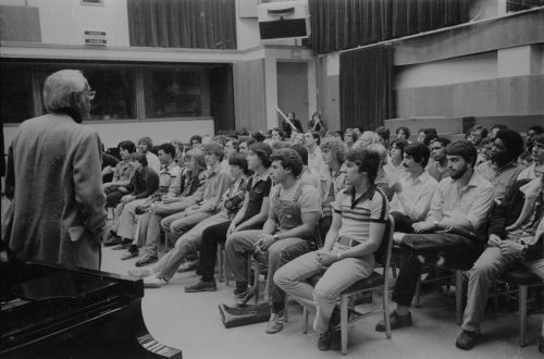 Attentive listeners in Room 120; Rayburn Wright is standing at left.