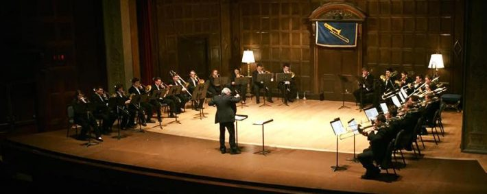 Trombone Choir onstage with conductor in Kilbourn Hall
