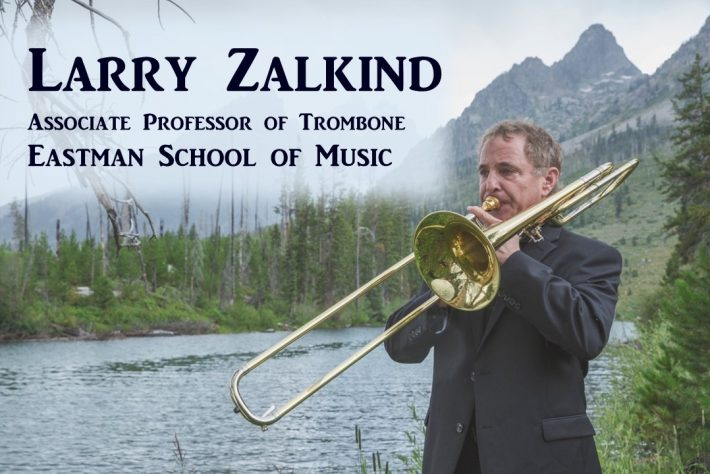 Larry Zalkind, Associate Professor of Trombone, Eastman School of Music, playing trombone with background of river and mountains