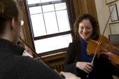 Photos of Eastman: Professor of Viola Carol Rodland in her studio