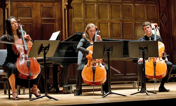 Three student cellists perform during A Day of Collaborative Music, January 2011
