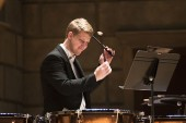 Photos of Eastman: A timpanist in the Eastman Philharmonia, during the opening concert of Prismatic Debussy, October 2013