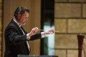 Photos of Eastman: Mark Davis Scatterday is music director of the Eastman Wind Ensemble.
