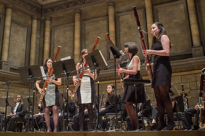 The bassoon quartet Breaking Winds, formed by Eastman students, returned to the school in February 2014 to perform with the Eastman Wind Ensemble.
