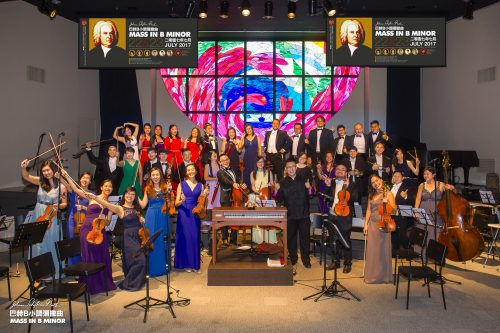 image of orchestra standing