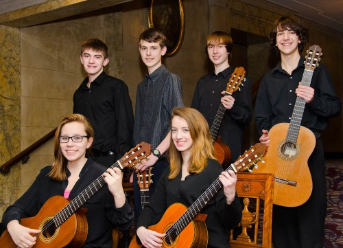 Members of the ECMS Youth Ensemble are, sitting from left: Oksana Miller and Addie Kurchin; standing, from left: Neil Ryan, John O'Leary, Luke Robbins, and David Steinhardt.