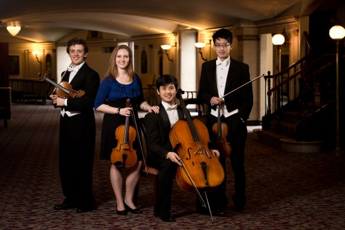 The Eastman String Quartet (from left, Markiyan Melnychenko, violin; Kelsey Farr, viola; Hyeok Kwon, cello; and Che Ho Lam, violin) will be playing at the Presidential Inaugural Luncheon on Monday, Jan. 21. (Adam Fenster/University of Rochester)