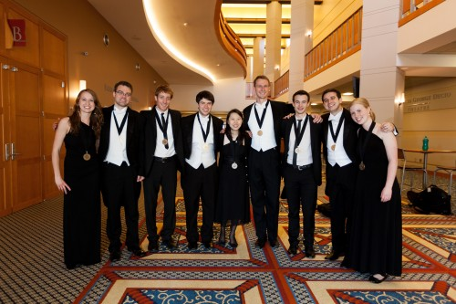 Members of Project Fusion and Midic Winds pose with their medals after the completion of the 2013 Fischoff National Chamber Music Competition. From left: Rebecca Tobin, Matt Evans, Quinn Delaney, Matt Amedio, June Kim, Michael Sawzin, Russell Rybicki, Dannel Espinoza, Johanna Gruskin. (Photo courtesy of Fischoff National Chamber Music Association and  photographer Josef Samuel.)