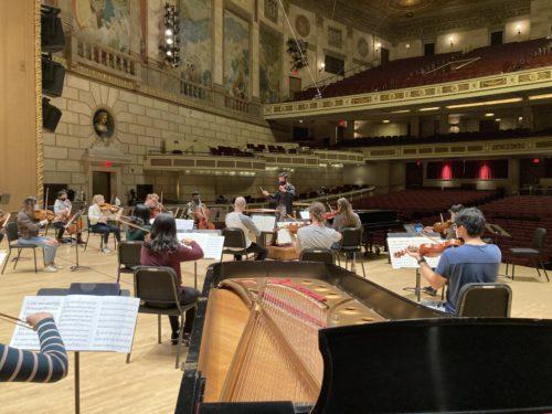 Austin Chanu rehearsing Banner with the Philharmonia strings in Kodak Hall