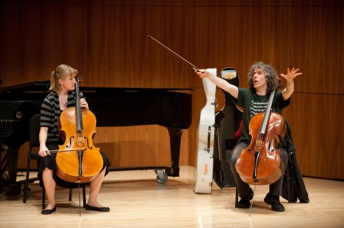 British cellist Steven Isserlis instructs Jamie Clark during a master class for Eastman students.