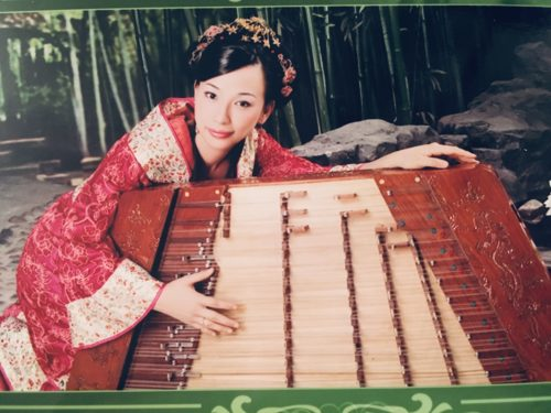 Wenzhuo Zhang with the Yangquin, or Chinese hammered dulcimer