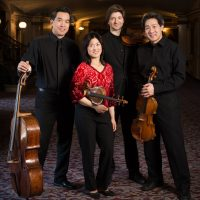 Ying Quartet, l-r: David Ying (cello), Janet Ying (violin), new first violinist Robin Scott, and Phillip Ying (viola) outside Kodak Hall at Eastman Theatre, Eastman School of Music March 23, 2015  // photo by J. Adam Fenster / University of Rochester